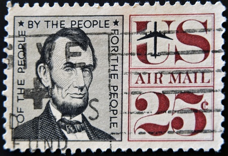 the statesman: UNITED STATES OF AMERICA - CIRCA 1966: A stamp printed by USA shows president Abraham Lincoln, circa 1966