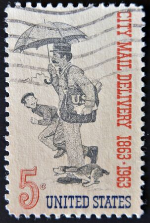 UNITED STATES OF AMERICA - CIRCA 1963: A stamp printed in the United States of America shows Letter Carrier, centenary of free city mail delivery, circa 1963  photo