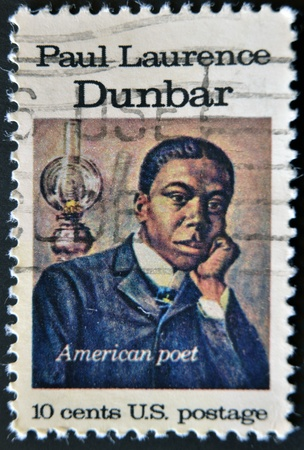 laurence: USA - CIRCA 1975 : A stamp printed in the USA shows Paul Laurence Dunbar, American Poet, circa 1975