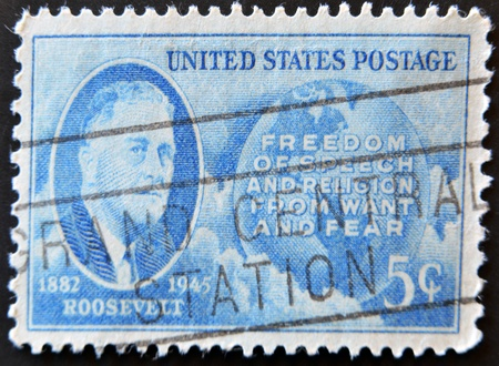 USA - CIRCA 1945: A stamp printed in the USA shows Roosevelt portrait, Freedom of speech and religion, from want and fear, 1882-1945, circa 1945