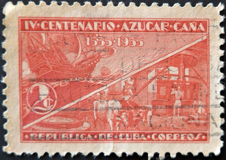CUBA - CIRCA 1935: A stamp printed in Cuba dedicated to the fourth centenary of the sugar cane, circa 1935 photo