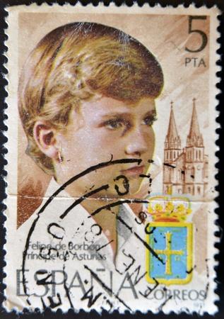 heir: SPAIN - CIRCA 1977: A stamp printed in Spain shows the Prince of Asturias, Felipe de Borbón, heir to the crown of Spain, circa 1977