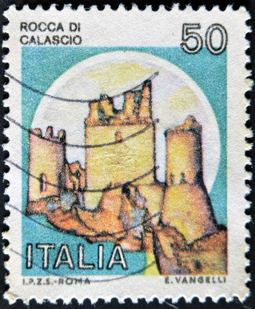 ITALY - CIRCA 1980: A stamp printed in Italy, shows Rock of Calascio, Italian series of castles , circa 1980  Stock Photo - 11582108