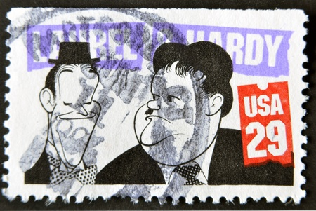 hardy: UNITED STATES OF AMERICA - CIRCA 1991; A stamp printed in USa shows the famous movie comedy duo of Stan Laurel and Oliver Hardy, circa 1991