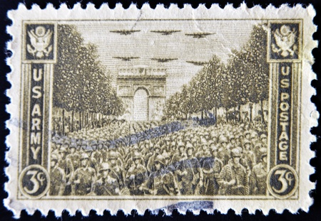 USA - CIRCA 1945 : stamp printed in USA show USA Army on the Champs Elysees, under the Arc de Triomphe in Paris , circa 1945  photo