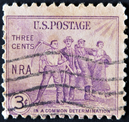 USA - CIRCA 1933 : A stamp printed in the USA shows Workers: National Recovery Act (N.R.A.), In a common determination, circa 1933  photo