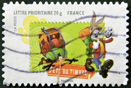 bugs bunny: FRANCE - CIRCA 2009: A stamp printed in France shows Bugs Bunny and Daffy Duck as scouts, circa 2009