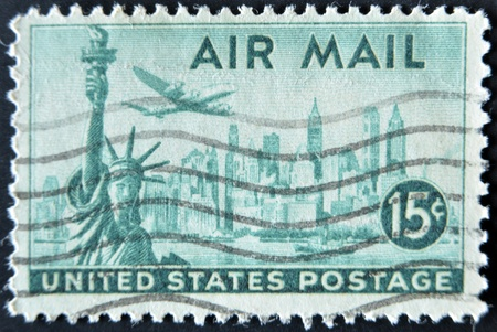 cancelled stamp: UNITED STATES OF AMERICA - CIRCA 1947: A stamp printed in USA shows plane over Statue of Liberty and New York, circa 1947