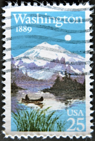 united states postal service: UNITED STATES OF AMERICA - CIRCA 1989: A stamp printed in USA shows image celebrating the 100th anniversary of Washingtons admission to the Union,  circa 1989  Stock Photo
