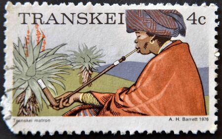 matron: REPUBLIC OF SOUTH AFRICA - CIRCA 1976: A stamp printed in Transkei shows transkei matron, circa 1976 Stock Photo