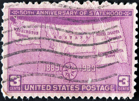 UNITED STATES - CIRCA 1939: A stamp printed in USA shows map of states, with inscription 50th Anniversary of Statehood, circa 1939  photo