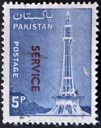 PAKISTAN - CIRCA 1978: A stamp printed in Pakistan shows Minar-e-Pakistan, Tractor and Mausoleum of Ibrahim Khan Makli, Tahtta, circa 1978  Stock Photo - 11723990
