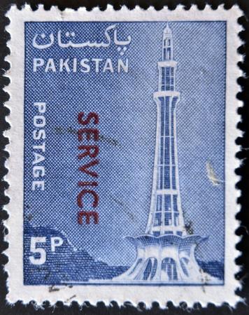 PAKISTAN - CIRCA 1978: A stamp printed in Pakistan shows Minar-e-Pakistan, Tractor and Mausoleum of Ibrahim Khan Makli, Tahtta, circa 1978 Stock Photo - 11723990