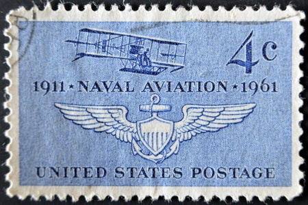 UNITED STATES - CIRCA 1961: stamp printed in USA shows Navys First Plane  and Naval Air Wings, circa 1961  photo