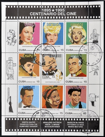 CUBA - CIRCA 1995: A stamp printed in Cuba dedicated to the centenary of cinema shows greta garbo, marlene dietrich, marilyn monroe, chaplin, lumiere, sica, bogart, montaner and cantinflas, circa 1995  Stock Photo - 11804333