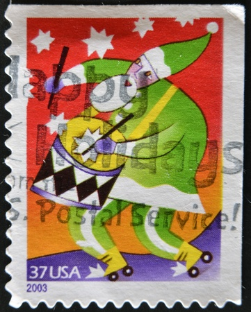 drumming: UNITED STATES OF AMERICA - CIRCA 2003: A stamp printed in USA, shows santa drawing drumming, circa 2003  Stock Photo