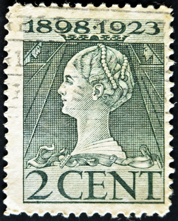 wilhelmina: HOLLAND - CIRCA 1923: A stamp printed in the Holland shows image of Queen Wilhelmina, circa 1923