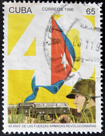 CUBA - CIRCA 1996: A stamp printed in Cuba dedicated to anniversary of the revolutionary armed forces, circa 1996 photo