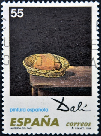 SPAIN - CIRCA 1994: A stamp printed in spain shows the work bread basket of Salvador Dali, circa 1994 photo