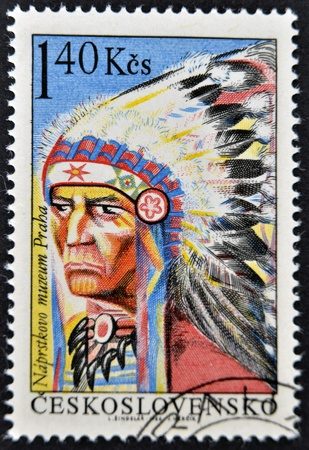 chieftain: CZECHOSLOVAKIA - CIRCA 1966: A stamp printed in Czechoslovakia shows a picture of native American Indian chieftain with feather headband, circa 1966