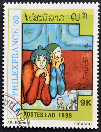 pablo: LAOS-CIRCA 1989: A stamp printed in the Laos shows painting arlequins by Pablo Picasso, circa 1989