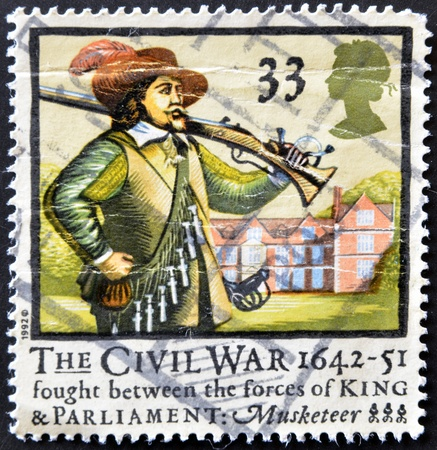 UNITED KINGDOM - CIRCA 1992: a stamp printed in the Great Britain shows Musketter, 350th anniversary of English civil war, circa 1992 Stock Photo - 11804047