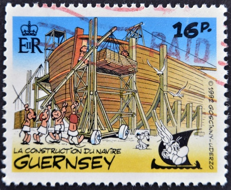 belonging: GUERNSEY - CIRCA 1992 : stamp printed in Guernsey shows bullet in the construction of an Egyptian ship, belonging to the comic Asterix and Obelix, circa 1992