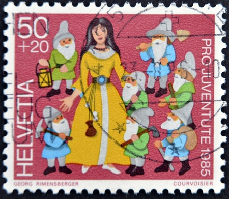 seven dwarfs: SWITZERLAND - CIRCA 1985: A stamp printed in Switzerland shows Snow White and the Seven Dwarfs, circa 1985  Editorial