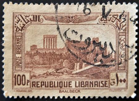 bacchus: LEBANON - CIRCA 1930: A stamp printed by Lebanon, shows Ruins of Bacchus Temple, Baalbek, circa 1930  Stock Photo
