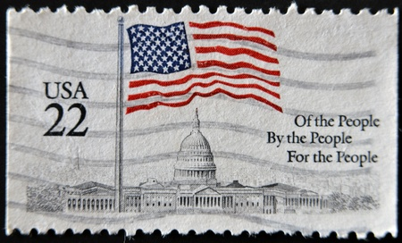 old stamp: UNITED STATES OF AMERICA - CIRCA 1985: A stamp printed in the USA shows Flag over Capitol, circa 1985