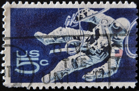 UNITED STATES - CIRCA 1962: stamp printed in USA shows Space Walking Astronaut, circa 1962  photo