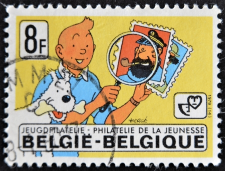 baggy: BELGIUM - CIRCA 1979: A stamp printed in Belgium shows the cartoon character, Tintin and his dog Snowy and captain Haddock, circa 1979  Editorial