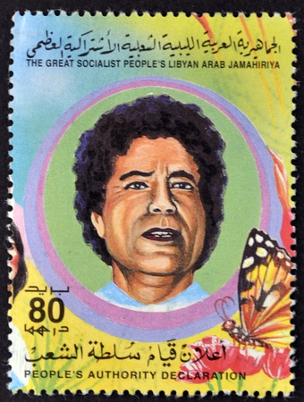 libyan: LIBYAN - CIRCA 1995: A Stamp printed in The Great Socialist Peoples Libyan Arab Jamahiriya shows Colonel Muammar Kaddafi, circa 1995