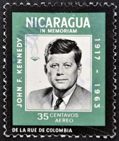 jfk: NICARAGUA - CIRCA 1963: A stamp printed in Nicaragua shows John F. Kennedy, circa 1963 Editorial