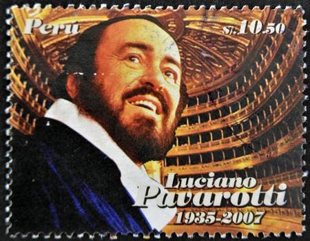 the tenor: PERU - CIRCA 2009: A stamp printed in Peru shows Luciano Pavarotti, famous tenor, circa 2009