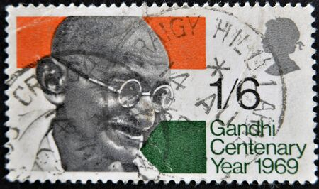UNITED KINGDOM - CIRCA 1969: a stamp printed in the Great Britain shows Mahatma Gandhi and flag of India, circa 1969