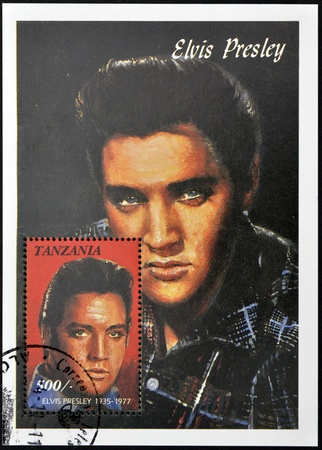 elvis presley: TANZANIA - CIRCA 1997: A stamp printed in Tanzania shows Elvis Presley, circa 1997