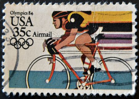 USA - CIRCA 1984: A stamp printed in USA from the Los Angeles Olympics 1984 issue, showing Bicycling , circa 1984.
