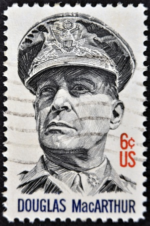 overprint: UNITED STATES OF AMERICA - 1971: A stamp printed in USA shows General Douglas MacArthur, 1971