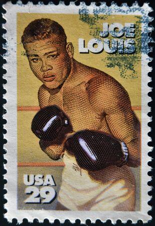 joe louis: UNITED STATES - CIRCA 1993 : stamp printed in USA shows Joe Louis, circa 1993