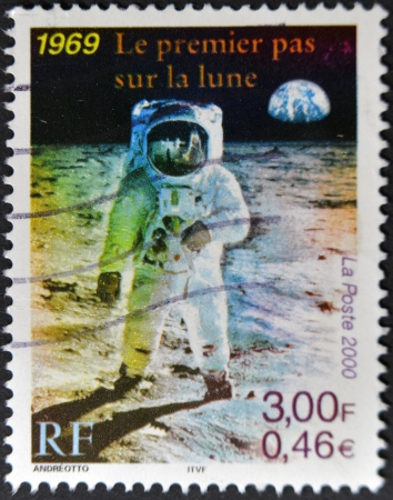 FRANCE - CIRCA 2000: A stamp printed in France shows the first man on the moon, Neil Armstrong, circa 2000 photo