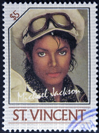 jackson: ST. VINCENT - CIRCA 1985: A stamp printed in St. Vincent shows Michael Jackson, circa 1985 Editorial