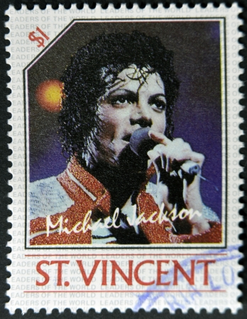 michael jackson: ST. VINCENT - CIRCA 1985: A stamp printed in St. Vincent shows Michael Jackson, circa 1985 Editorial