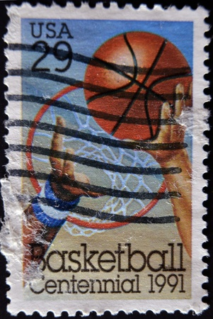 UNITED STATES - CIRCA 1991: stamp printed in USA shows Basketball, Hoop, Players Arms, circa 1991  photo