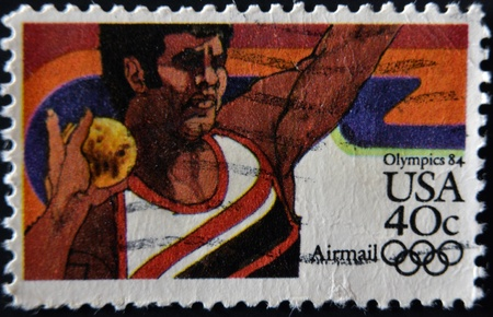 olympiad: UNITED STATES OF AMERICA - CIRCA 1984: A stamp printed in the USA shows image of a shot putter and commemorates the 1984 Los Angeles Olympics, circa 1984