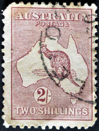 AUSTRALIA - CIRCA 1913: A stamp printed in Australia shows the Kangaroo and Map, circa 1913 photo