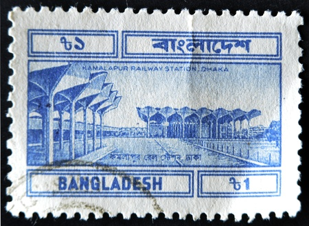 BANGLADESH - CIRCA 1994: A stamp printed in Bangladesh shows Kamalapur Railway Station in Dhaka, circa 1994  photo