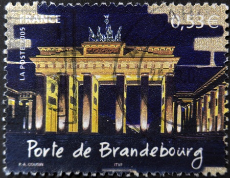 FRANCE - CIRCA 2005: A stamp printed in France shows Brandenburg Gate at night, circa 2005 photo