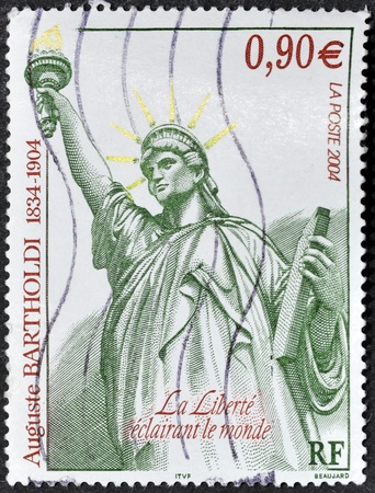 FRANCE - CIRCA 2004: A stamp printed in France dedicated to Bartholdi shows the Statue of Liberty, circa 2004 photo