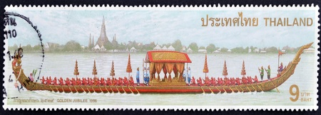 perforated stamp: THAILAND - CIRCA 1996: A stamp printed in Thailand shows image of The Royal Barge with the inscription Golden Stock Photo
